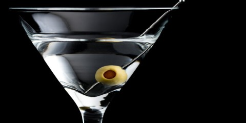 Vodka martini cocktail with olive